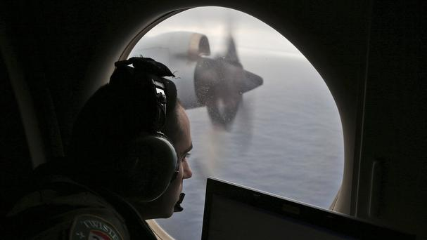 Flight officer Rayan Gharazeddine, on board a Royal Australian Air Force AP-3C Orion, searches for the missing Malaysia Airlines Flight MH370 in the southern Indian Ocean (AP)