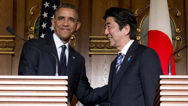 US president Barack Obama and Japanese prime minister Shinzo Abe shake hands at the conclusion of their joint news conference in Tokyo (AP)