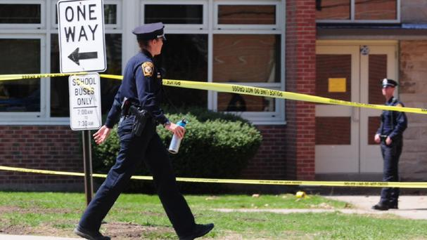 Police at Jonathan Law High School in Milford, Connecticut, where a 16-year-old girl was stabbed to death (AP/The New Haven Register, Peter Hvizdak)
