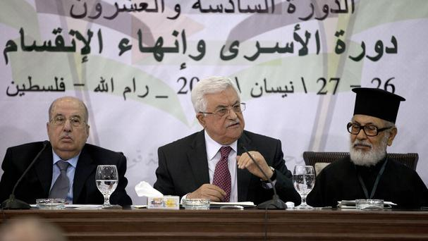 Palestinian president Mahmoud Abbas, middle, speaks during a meeting with the Palestinian Central Council (AP)