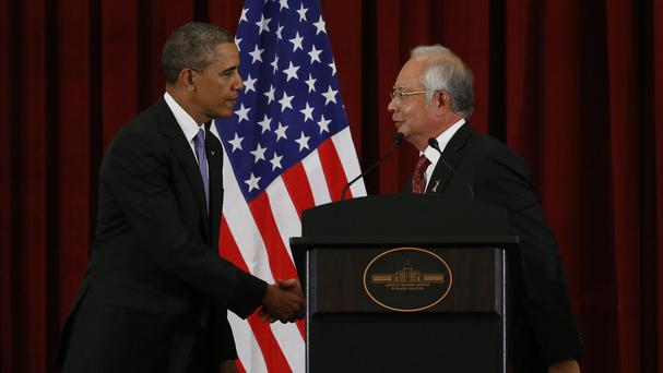 President Barack Obama and Malaysian PM Najib Razak shake hands at the end of a joint news conference (AP Photo/Charles Dharapak)