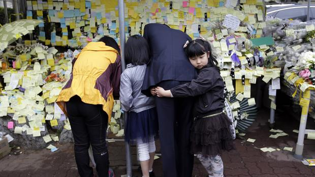 Messages in memory of the dead from the Sewol ferry disaster are posted at Danwon High School (AP)