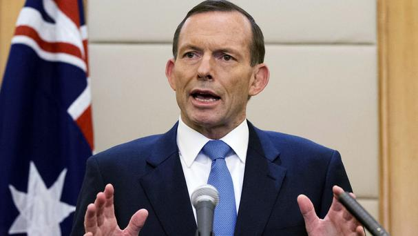 Australia's prime minister Tony Abbott has said the underwater search for the missing Malaysia Airlines plane is to be widened (AP)