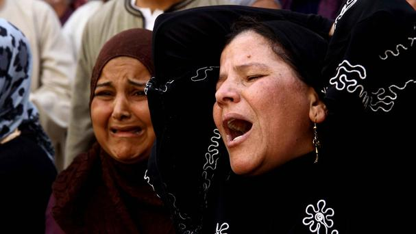 Women weep after a judge sentenced to death more than 680 alleged supporters of the Egypt's ousted Islamist president over acts of violence and the murder of policemen in the latest mass trial (AP)