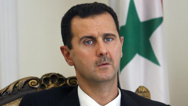 President Bashar Assad has declared his candidacy for the June 3 presidential elections in Syria (AP)