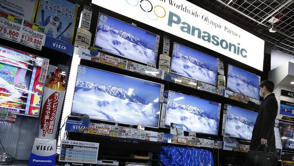 Panasonic returned to profit after deep losses for the past two fiscal years, as a weak yen and restructuring efforts helped a gradual recovery (AP)
