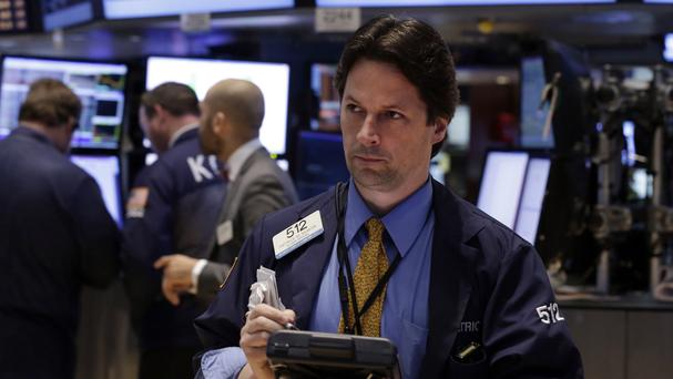 Trader Patrick McKeon works on the floor of the New York Stock Exchange (AP)