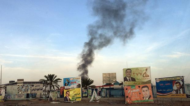 A series of bombings in Iraq are an apparent effort by militants to discourage voters from going to the polls