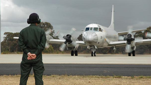 A Japanese plane leaves an Australian air base in the search for missing Malaysia Airlines flight MH370 (AP)