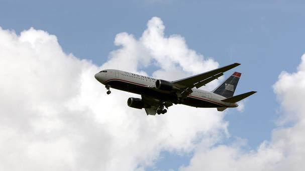 A teenage boy survived a five-hour flight from California to Hawaii after climbing into the wheel well of a Boeing 767