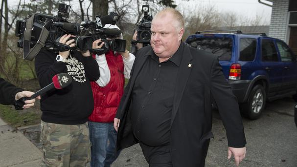 Toronto mayor Rob Ford leaves his home after saying he will take a leave of absence to seek help over alcohol (AP)