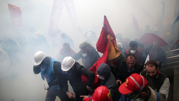 Riot police use water cannons and tear gas to disperse thousands of people trying to reach Taksim Square in Istanbul, Turkey, to mark May Day (AP)