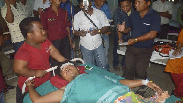 A man injured in a rebel attack in Assam receives treatment at a civil hospital in Kokrajhar (AP)