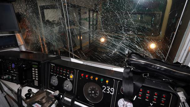 A window of a train is broken after a collision at Sangwangshipri subway station in Seoul, South Korea (AP)