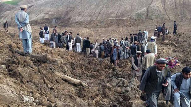 Afghans search for survivors after a massive landslide buried a village in Afghanistan (AP)