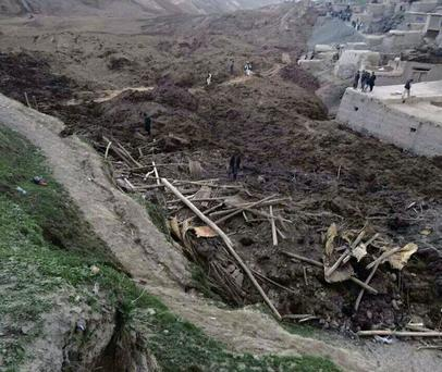 Afghan villagers gather at the site of the landslide in Badakhshan province.
