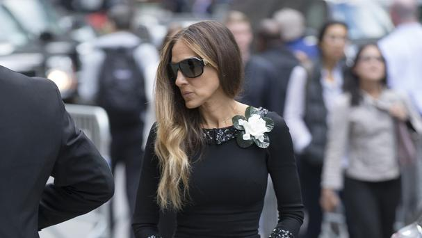 Actress Sarah Jessica Parker arrives for the memorial service for L'Wren Scott (AP)
