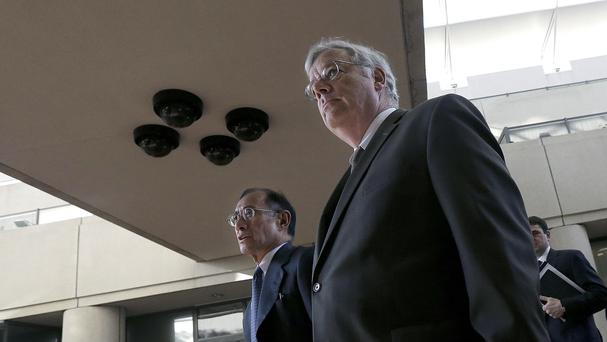 Apple lawyers Harold McElhinny, foreground, and William Lee walk into court during the battle with Samsung (AP)