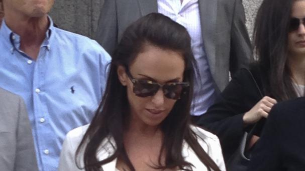Molly Bloom, known as the Poker Princess, leaves court after a judge said prison would be too harsh a punishment (AP)