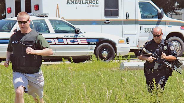 Police responding to a shooting in Arkansas that left four people dead, including the gunman (AP)
