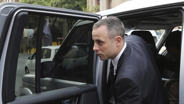 Oscar Pistorius arrives at the High Court in Pretoria, where his trial continues (AP Photo/Themba Hadebe)