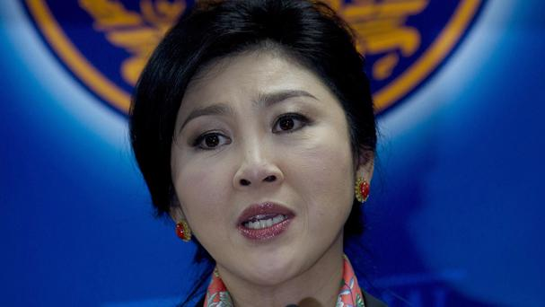 Thai PM Yingluck Shinawatra talks during a press conference in Bangkok after she was ordered to step down (AP)