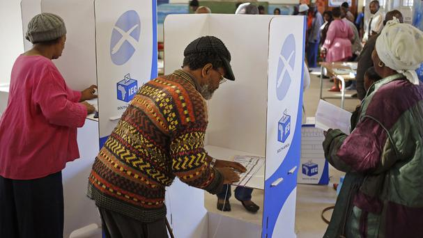 A voter makes his mark on a ballot at a polling station in the township of Nyanga on the outskirts of Cape Town, South Africa. (AP)