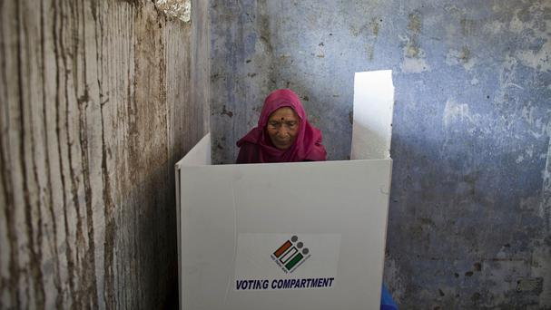 An Indian woman casts her vote during the eighth phase of voting in the Indian parliamentary elections, in Dharmsala, Himachal Pradesh state (AP)