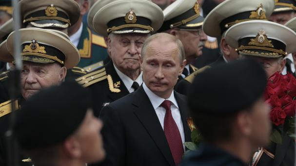 Russian President Vladimir Putin attends a parade marking Victory Day in Crimea (AP)