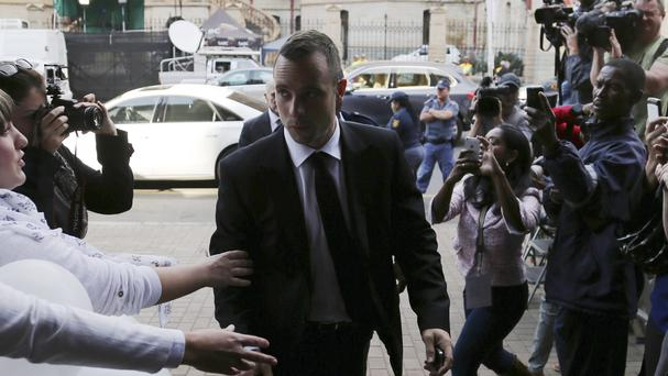 Oscar Pistorius is greeted by fans on his arrival at the high court in Pretoria (AP Photo/Themba Hadebe)
