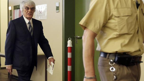 Formula One boss Bernie Ecclestone leaves the courtroom on the third day of his trial in Munich (AP)