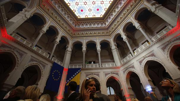 Visitors at the newly reopened National Library in the Bosnian capital of Sarajevo (AP)