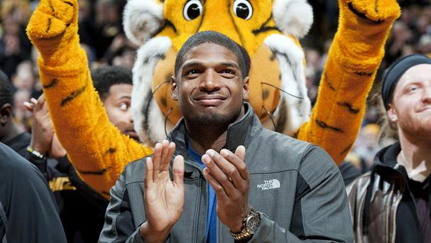 Michael Sam will be the first openly gay player in the NFL after being drafted by St Louis Rams (AP)