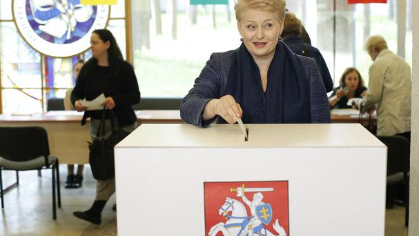 Lithuania's President Dalia Grybauskaite casts her ballot at a polling station during the first round of voting in presidential election in Vilnius