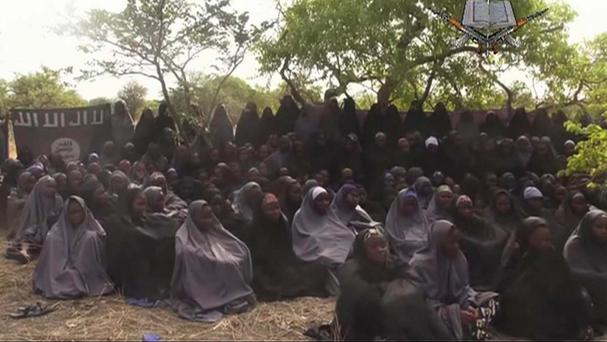 A new video by Nigeria's Boko Haram terrorist network purports to show dozens of the abducted schoolgirls (AP)