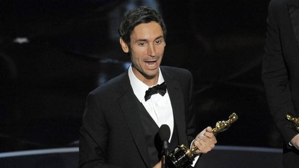 Director Malik Bendjelloul accepting his Oscar for Searching For Sugar Man. He has died aged 36 (AP)