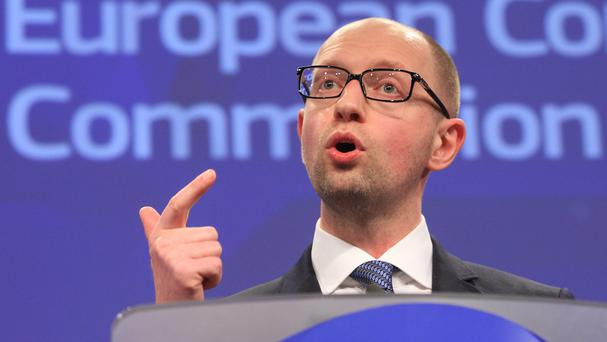 Ukrainian prime minister Arseniy Yatsenyuk addresses the media at the European Commission headquarters in Brussels (AP)