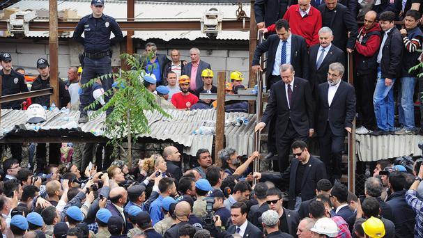 Recep Tayyip Erdogan is surrounded by security guards as he visits the coal mine in Soma, western Turkey (AP)