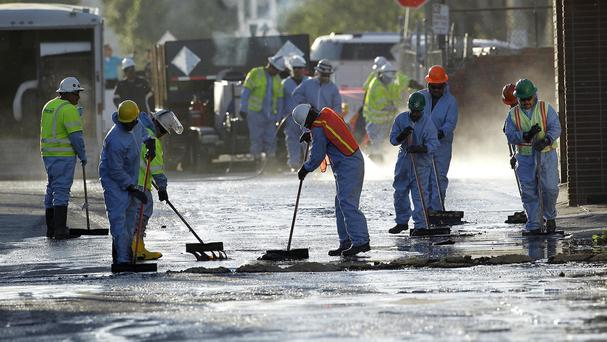 Crews mop up the remains of about 10,000 gallons of crude oil in Los Angeles (AP)