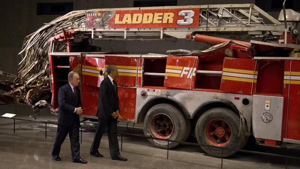 US President Barack Obama and former New York City Mayor Michael Bloomberg tour the destroyed Ladder 3 truck at the September 11 Memorial Museum in New York (AP)