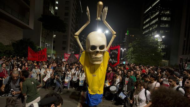Hundreds of demonstrators protest against money spent on the World Cup preparations in Sao Paulo (AP)