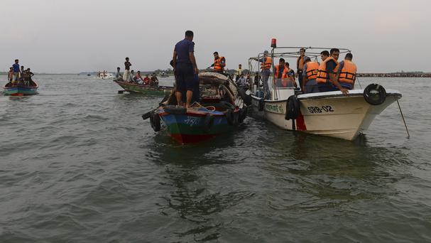 Bangladeshi rescuers look for bodies of victims from the River Meghna after a ferry capsized (AP)