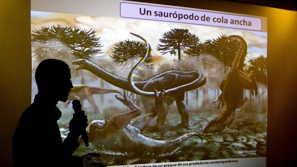 Paleontologist Pablo Gallina speaks to the press about a newly discovered dinosaur discovered in Argentina (AP)