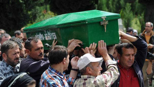 People carry the coffin of a mine accident victim in Soma, Turkey (AP)