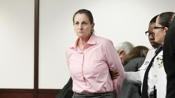 Julie Schenecker is escorted from the courtroom (AP)
