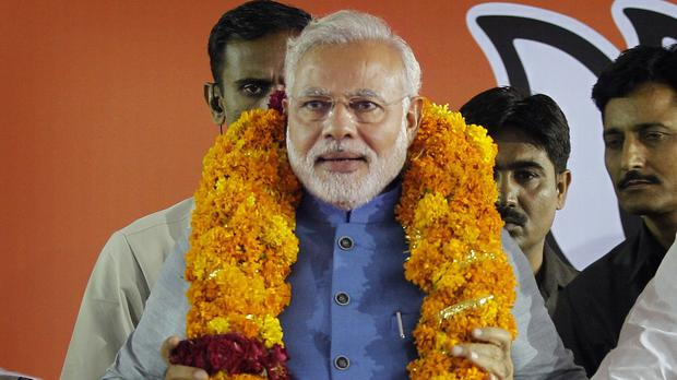 India's next prime minister Narendra Modi greets the gathering at the home of his 90-year-old mother in Gandhinagar (AP)