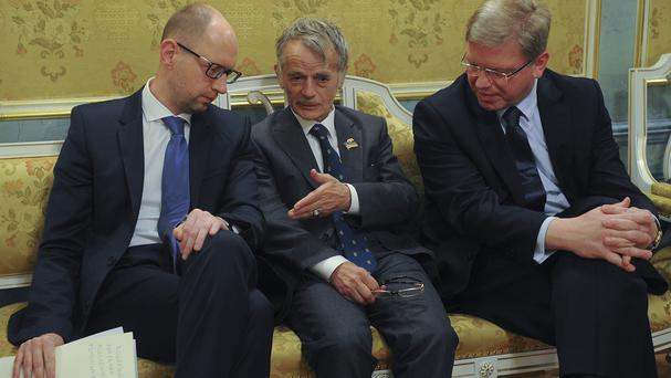 From left, Ukrainian prime minister Arseniy Yatsenyuk, a Crimean Tatar leader Mustafa Dzhemilev, and Ukrainian legislator Stefan Fule in Kiev (AP)