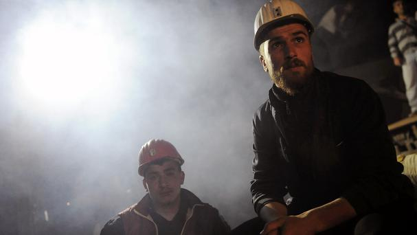 Turkish miners at the entrance of the coal mine in Soma, as a new fire hampered efforts to complete the search of the mine (AP)