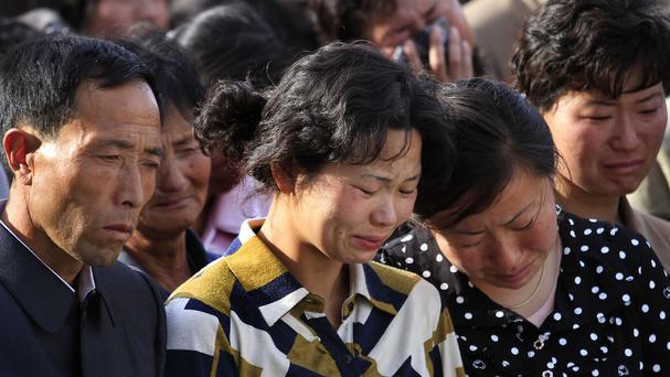 Families of victims of an accident at an apartment construction site in Pyongyang, North Korea, grieve during a gathering in the capital (AP)