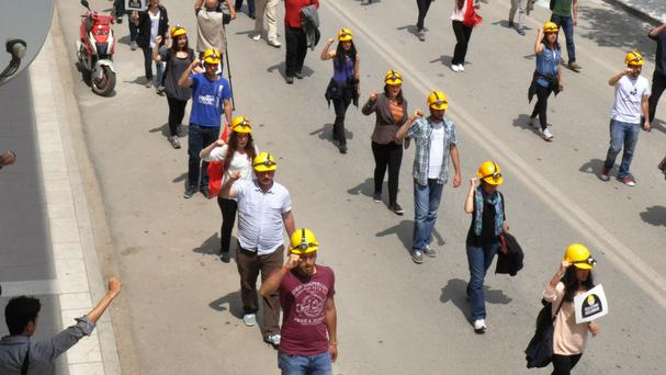 Several hundred members of the Union of Turkish Youth wear miner's helmets during a march to commemorate the Soma coal mine victims, in Amasya, Turkey